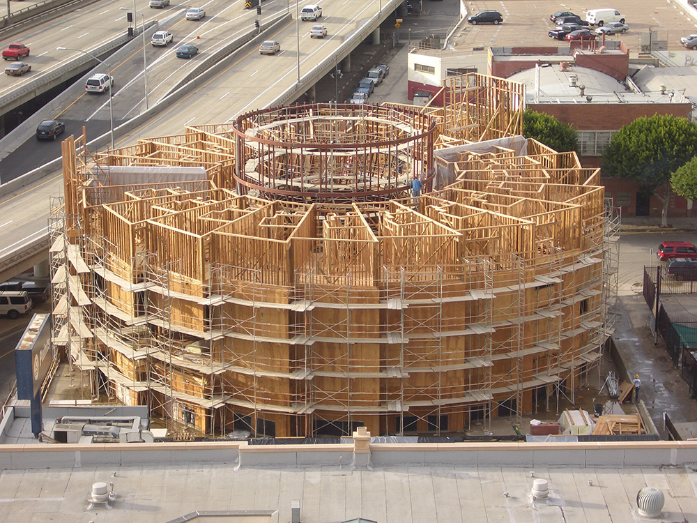 The New Carver Apartments housing under construction, showing wooden structure