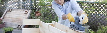 Woman building a wooden bench