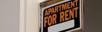 Apartment for rent sign.