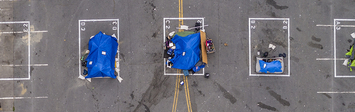 Aerial view of a city sanctioned camp for people experiencing homelessness in San Francisco blocks from City Hall.